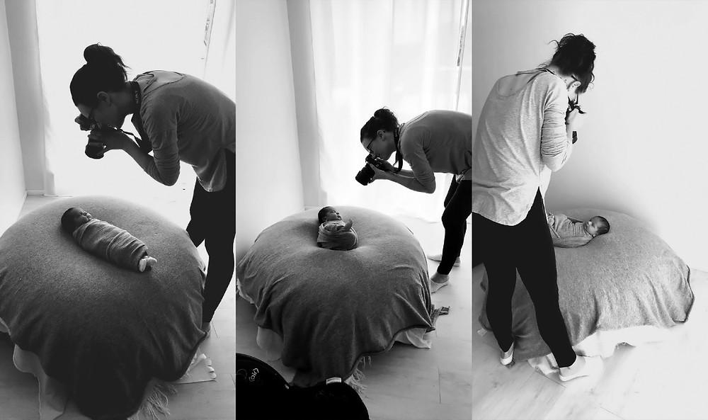 Newborn Photographer standing over baby with camera