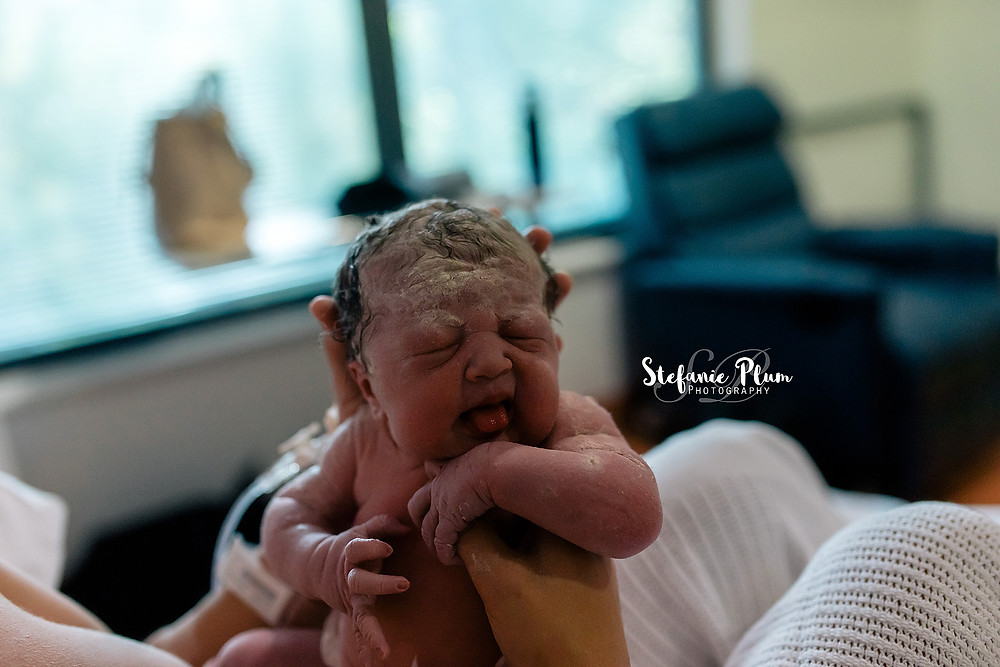 Newborn baby just born in hospital room Brisbane birth photographer