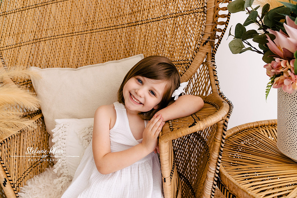 Girl Posing on rattan peacock chair