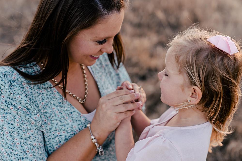 Mum holding little girls hands