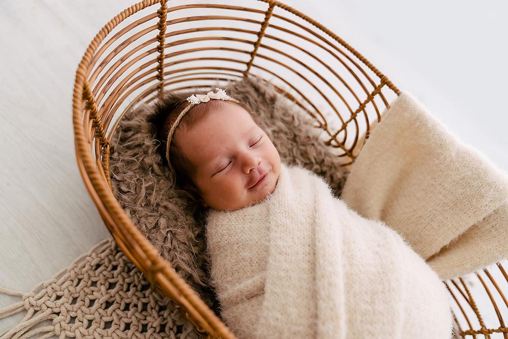 Baby sleeping in cane basket