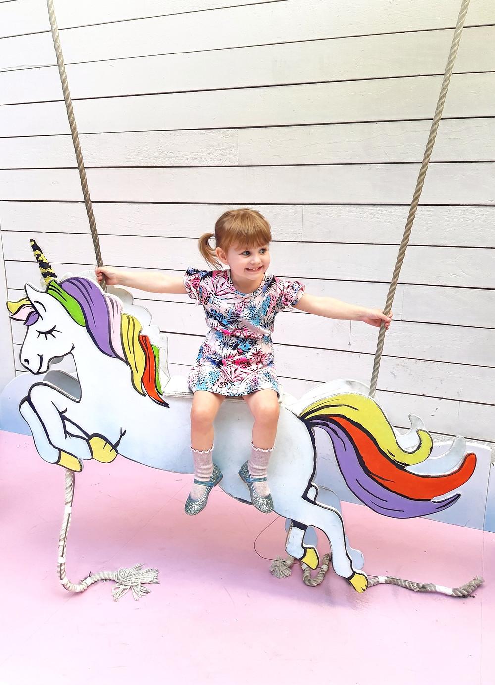 Girl on Unicorn swing