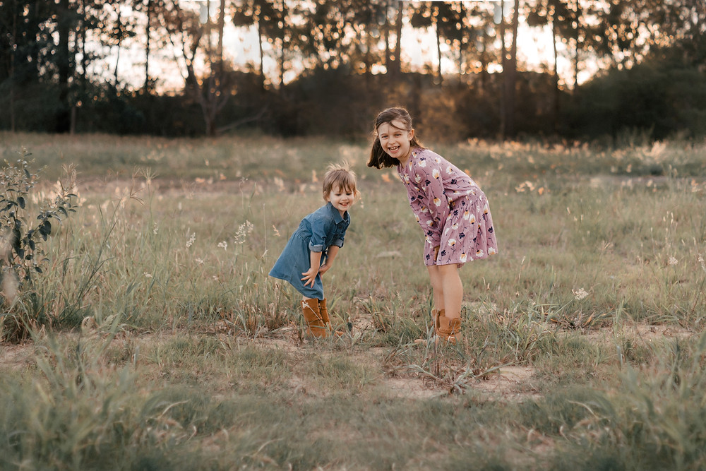 Two girls playing in a field