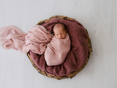 How old should my baby be for newborn photos?