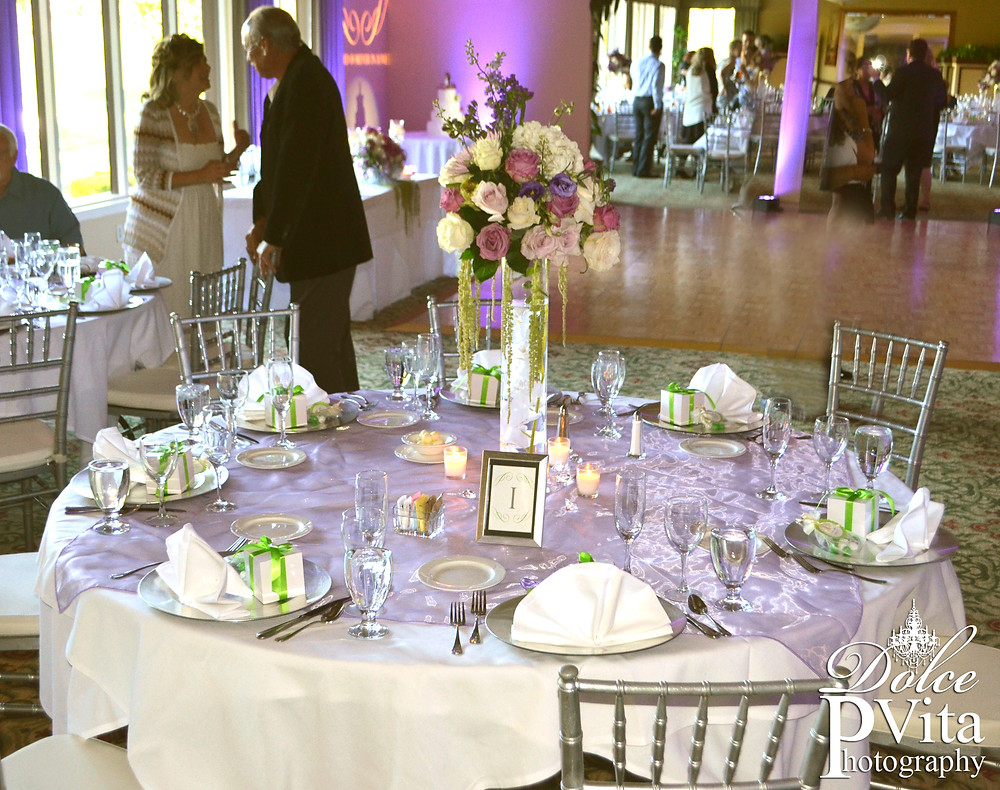 Dolce Vita Events custom designed wedding reception tables with fresh rose and hydranea tall cylinder centerpieces, candles, and silver chiavari chairs