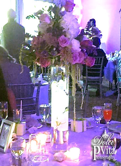 Tall cylinder lit centerpiece with lavender and white roses by Dolce Vita Events