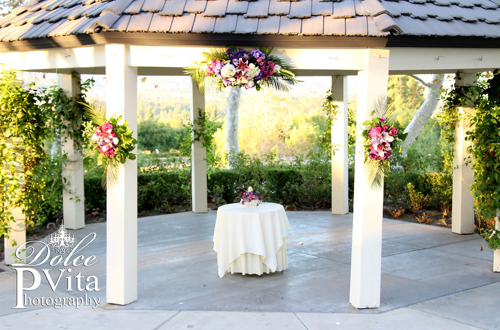 Dolce Vita Events Tropical Purple, white, plum Gazebo Altar flowers at Summit House Orange County
