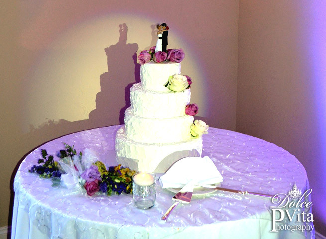 White four tier wedding cake with fresh lavender and white roses by Dolce Vita Events