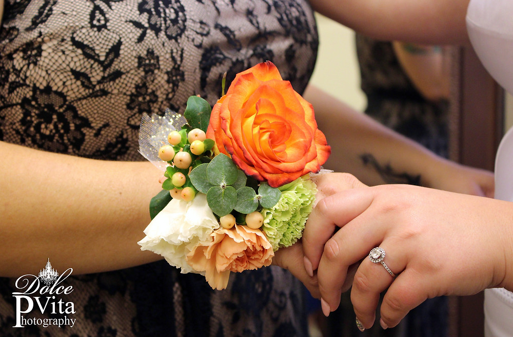 Mother of the Bride coral and cream floral wrist corsage
