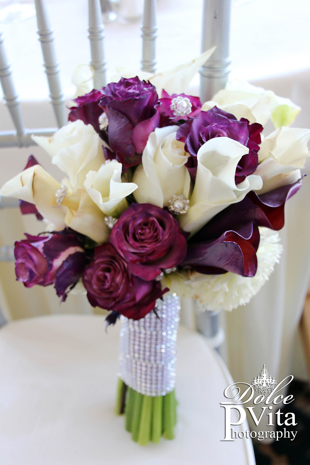White calla lilies, white plum roses bridal bouquet with pear and rhinestone details by Dolce Vita Events in Orange County