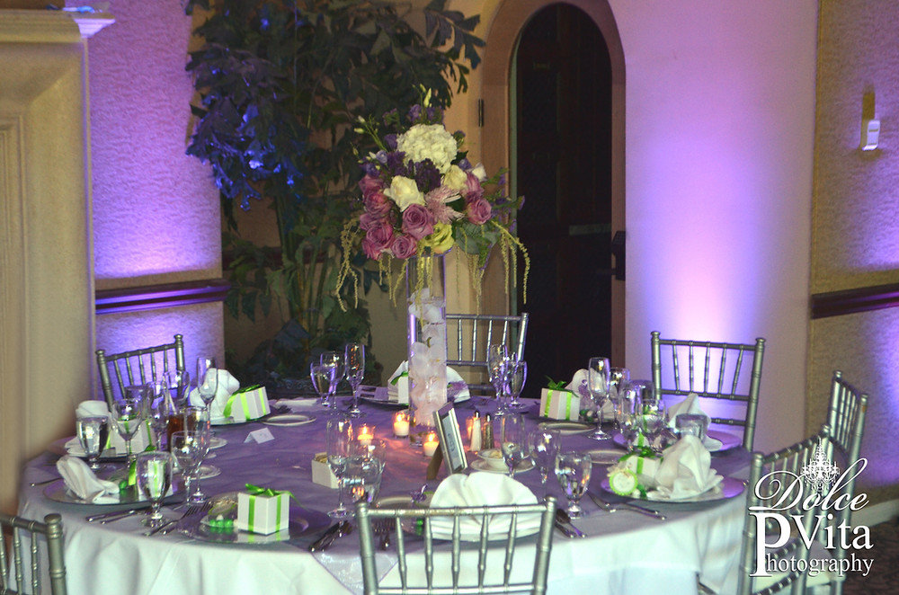 Tall cylinder centerpiece with water floating magnolia and candles, lavender, purple rose flowers and hydrangea by Dolce Vita Events