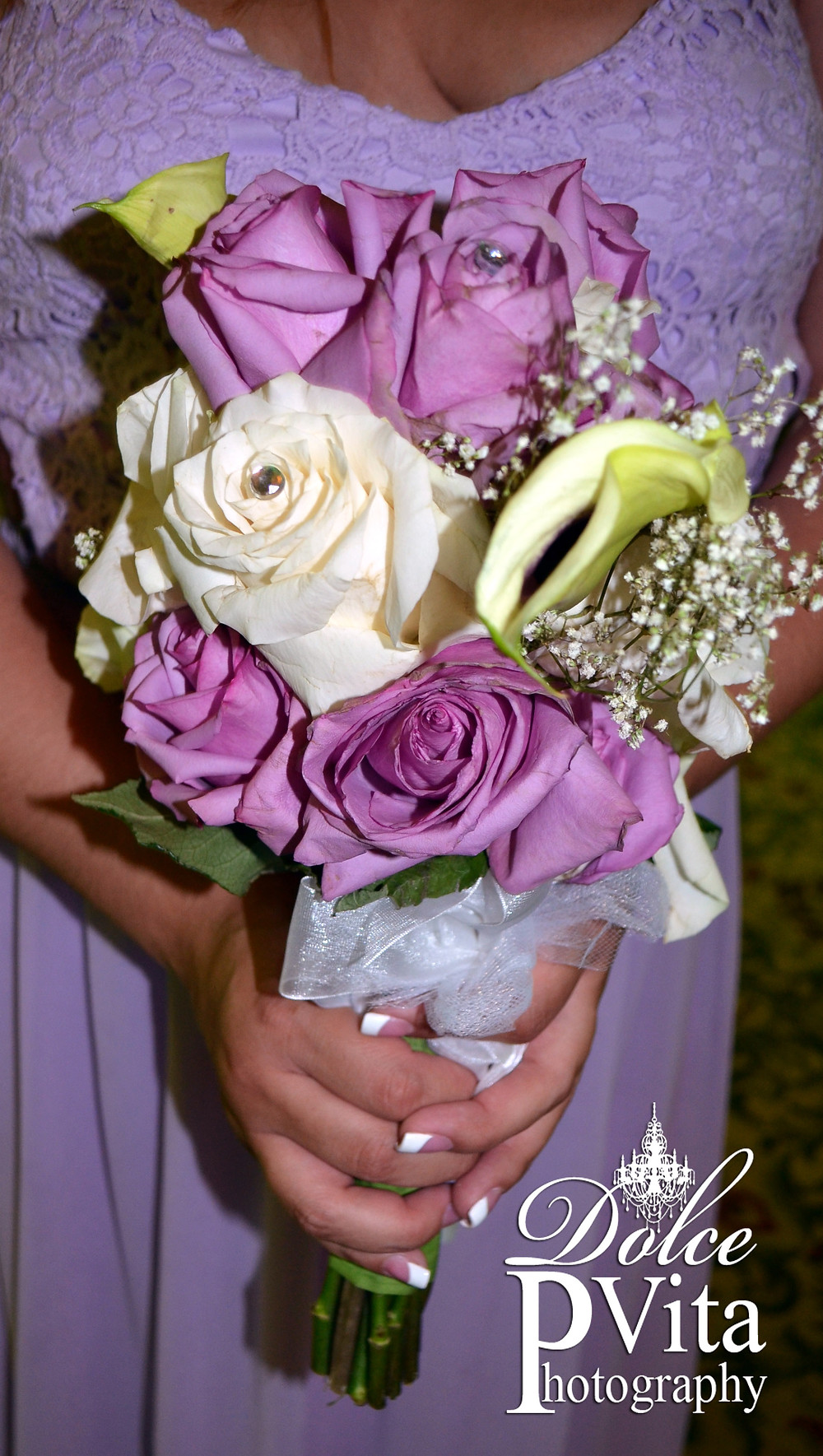 Lavender and Whte roses with cala lilies and baby's breath toss bouquet with rhinestone accents by Dolce Vita Events