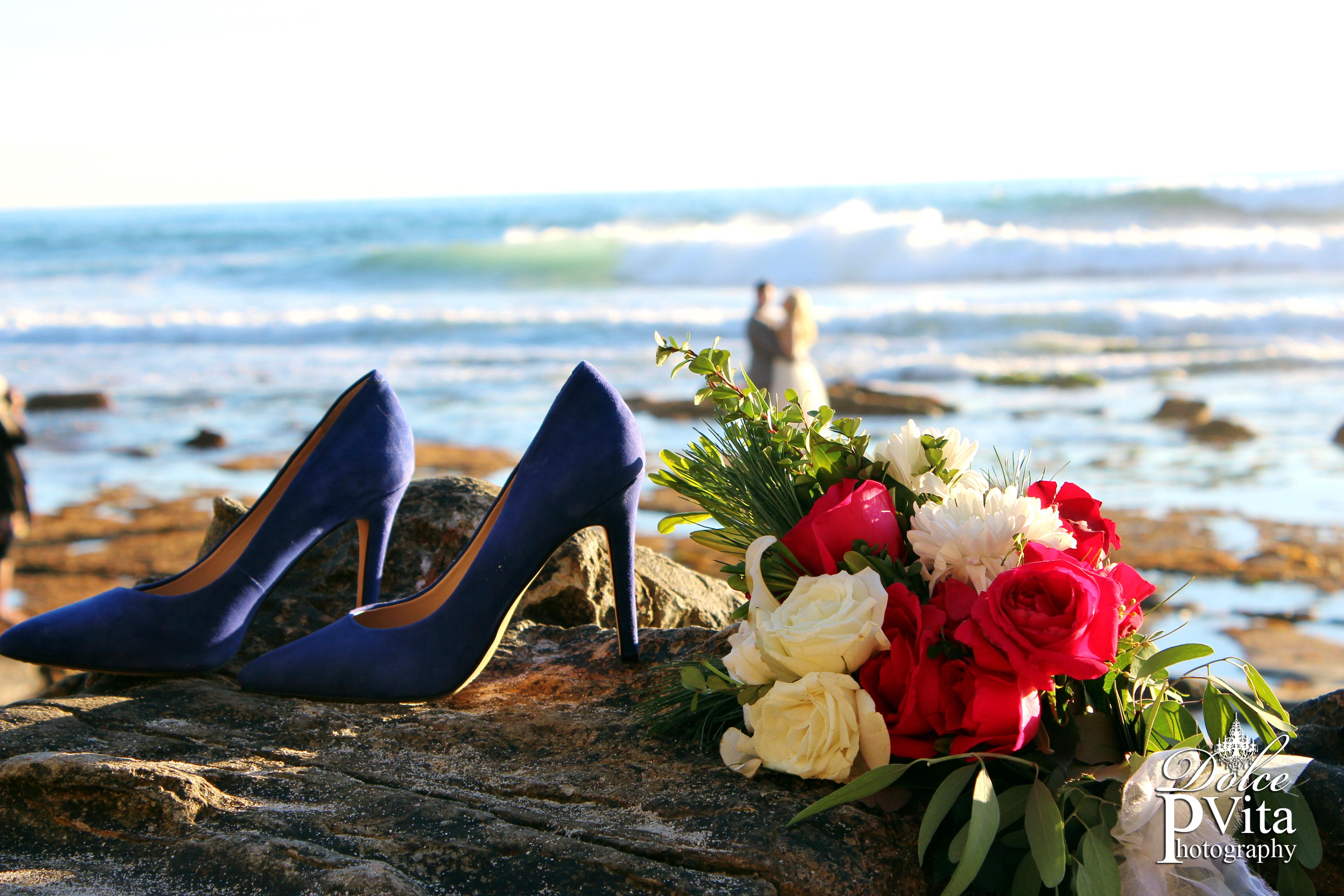 Brides bouquet on sand Laguna Beach