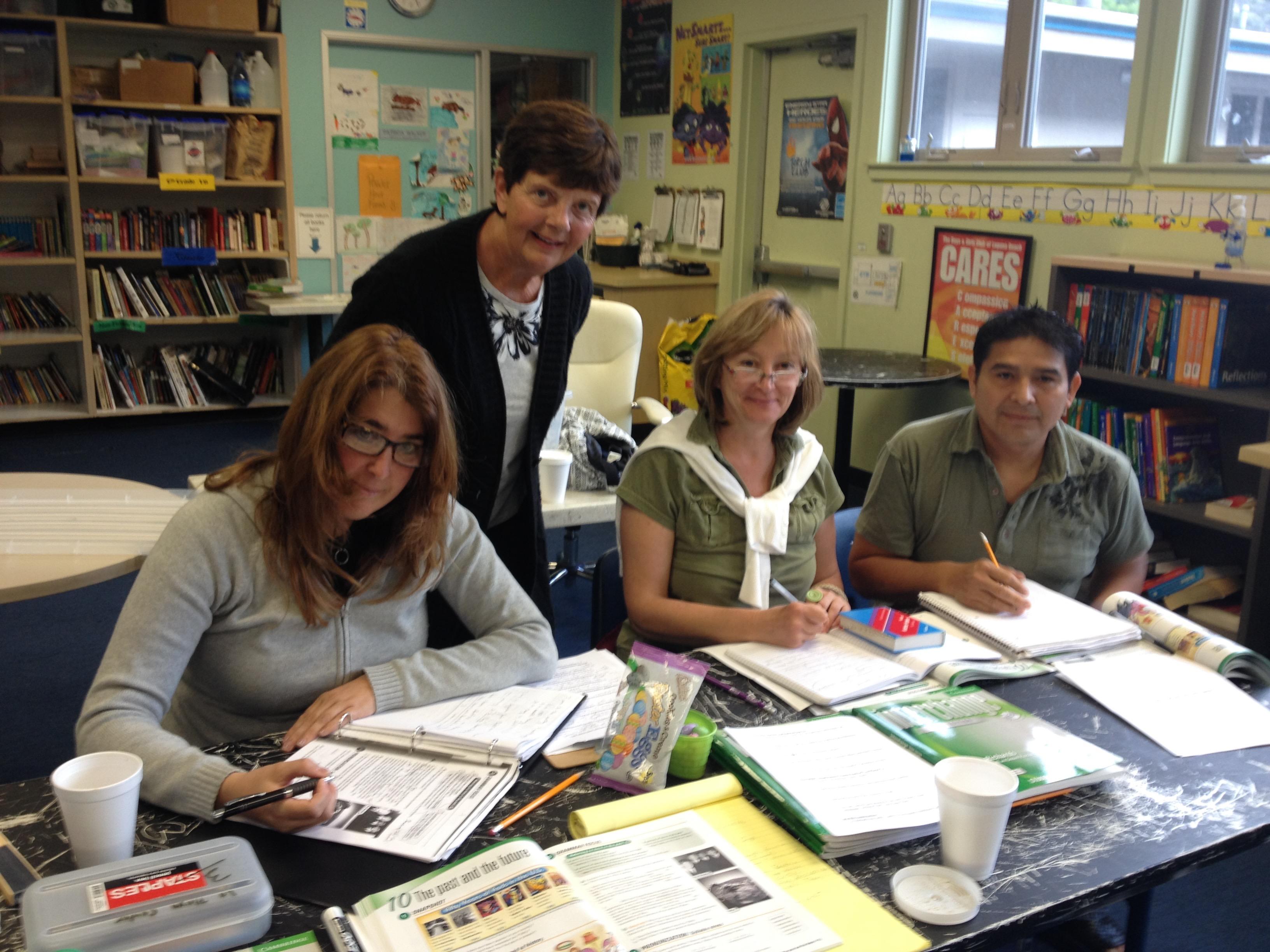 Beatriz Alvarez, Krisztina Fulep and  Mauricio Cruz with volunteer teacher, Janet Walters.