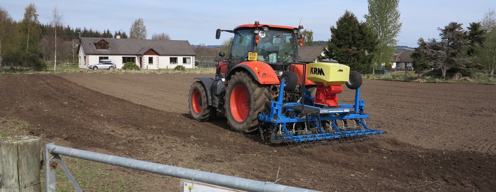 tractor sowing in Nethybridge on 5th May