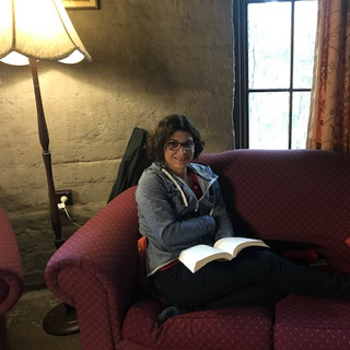 Mel relaxing in the library at The Monas