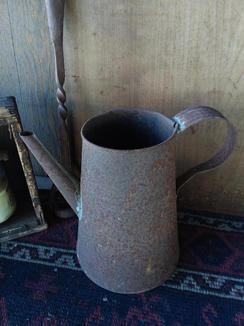 Rusty tin coffee pot