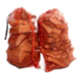Orange string sacks of domestic logs ad kindling