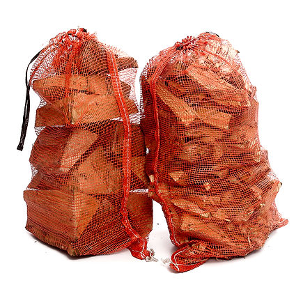 Orange string sacks of domestic logs ad kindling