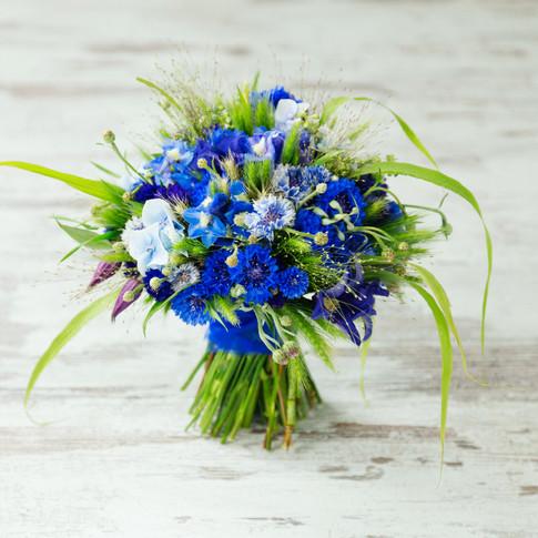 Wheat and cornflower wedding bouquet.
