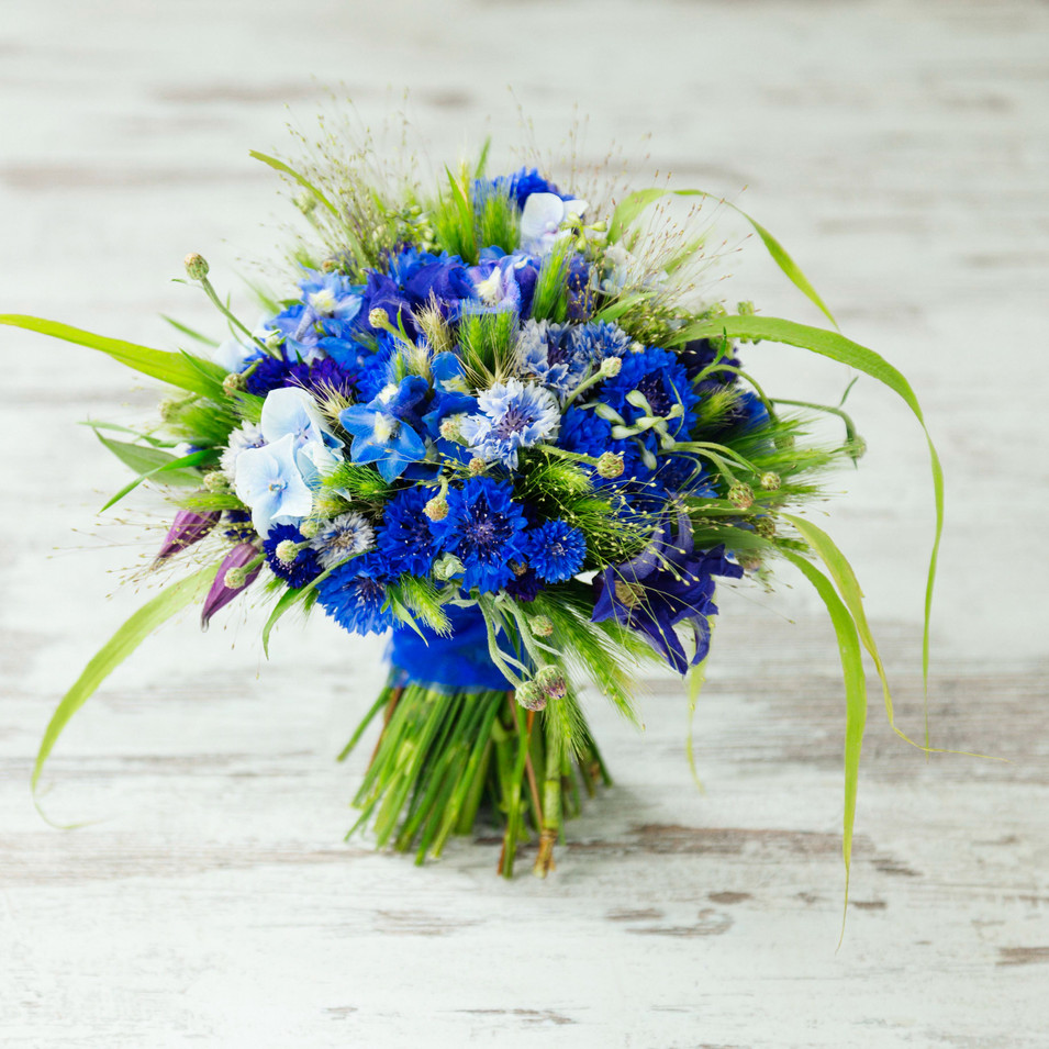 Wheat and cornflower wedding bouquet.