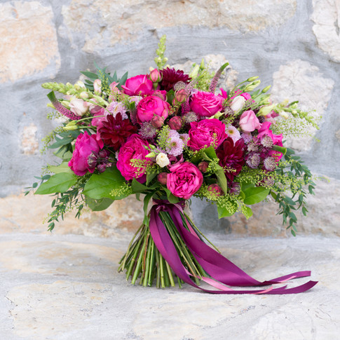 bright red wedding bouquet on the stone