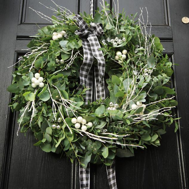 Eucalyptus Christmas wreath hung on a bl