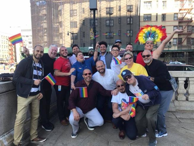 Group photo at pride flag raising