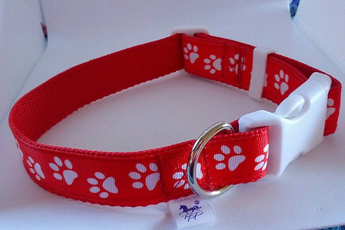 Red dog adjustable dog collar with white paw print pattern