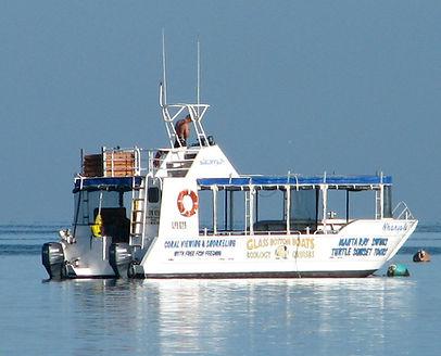 Nhanya Khu, glass bottom boat of Coral Bay Ecotours