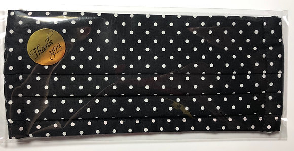 Black w/ white polka dots. Adult size