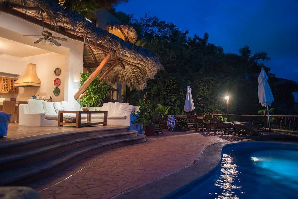 villa bahia pool at night zihuatanejo mexico