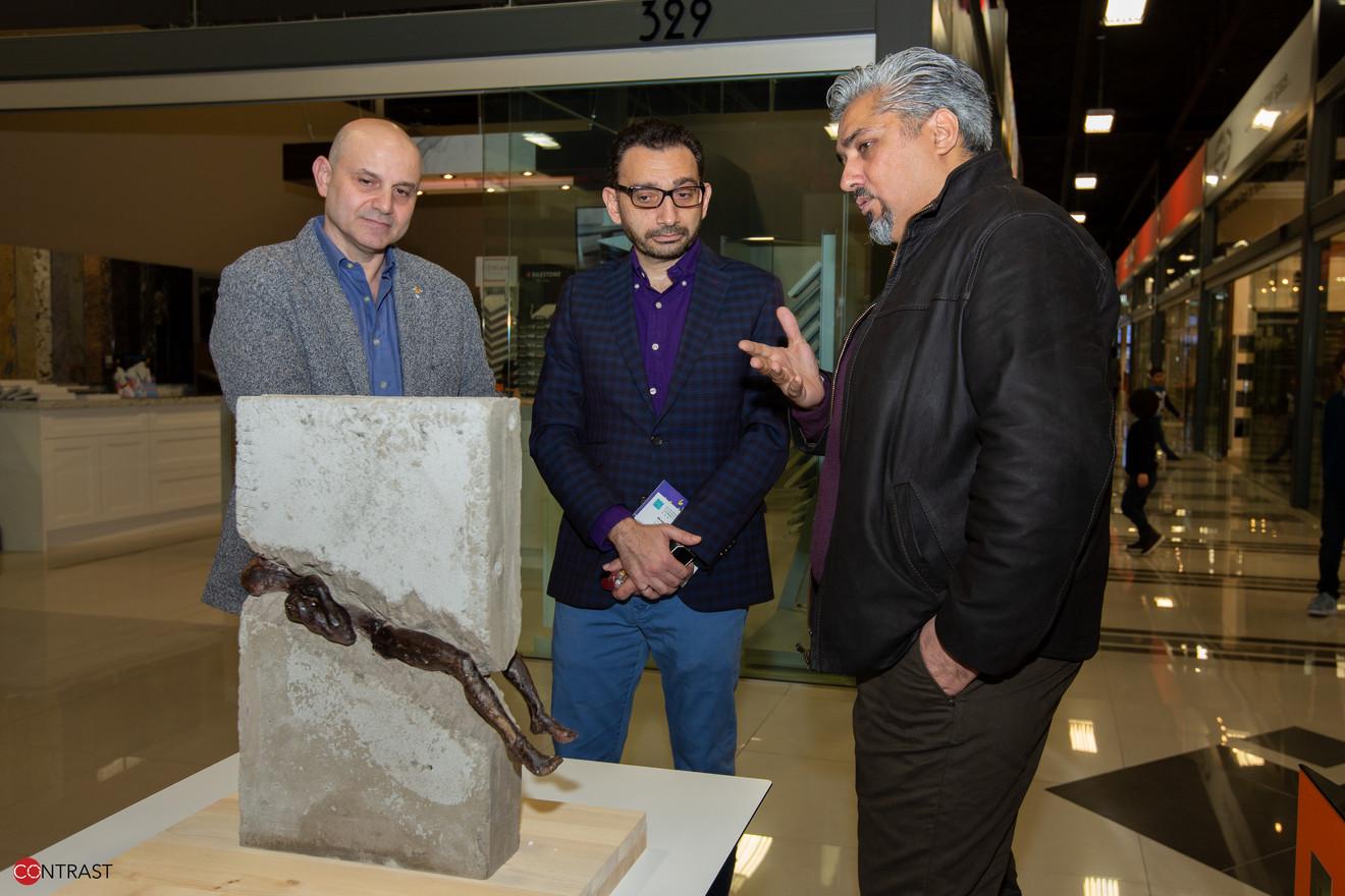 Artist Mohanad Kasmi explaning his artwork to MP Omar Alghabra