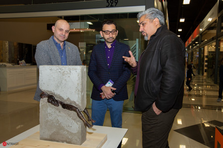 Artist Mohanad Kasmi explaning his artwork to MP Omar Alghabra