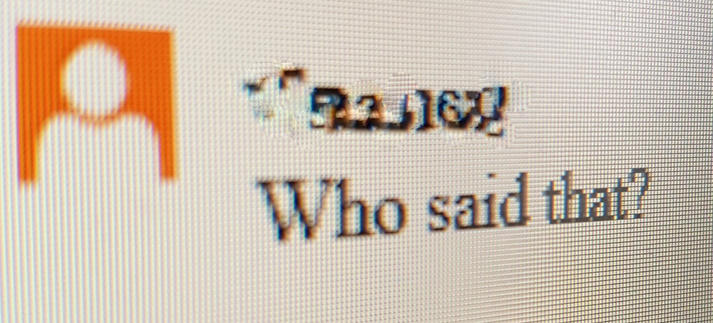 "A photo of a comment on a manuscript with the text ""Who said that?"""