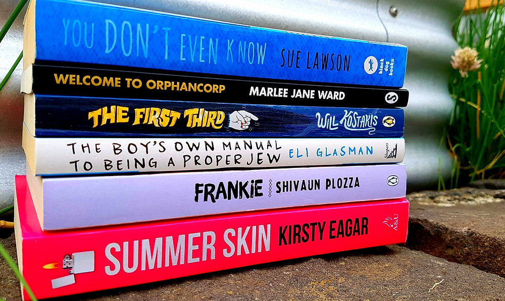 A photo of: You Don't Even Know by Sue Lawson; Marlee Jane Ward's Welcome to Orphancorp; The first Third, Will Kostakis; The Boy's Own Manual to Being a Proper Jew by Eli Glasman; Shivaun Plozza's Frankie; and Kirsty Eagar's Summer Skin.