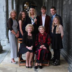 Graduation portrait family.