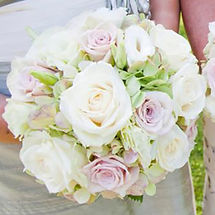 Handtied wedding bouquet roses and hydrangeas