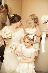 bride with flowers and bridemaids