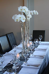 white orchids on wedding venue table