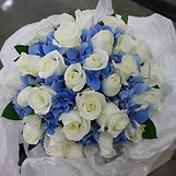 Wedding bouquet in whites blues and purples