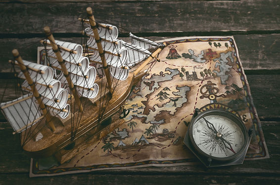 Pirate ship, treasure map and a compass