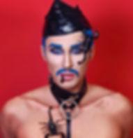 Portrait of Queer Artist Percy Katt wearing BDSM Collar.