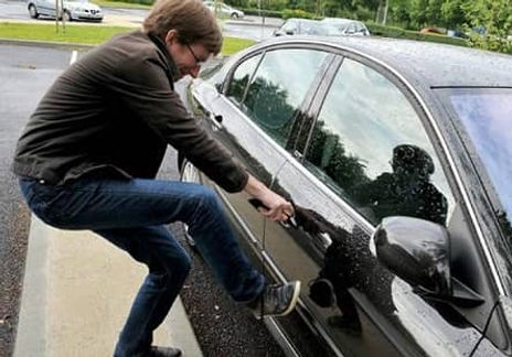 A man trying to open his car door