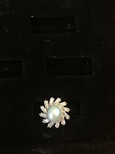 flower with crystal petals and teal pearl
