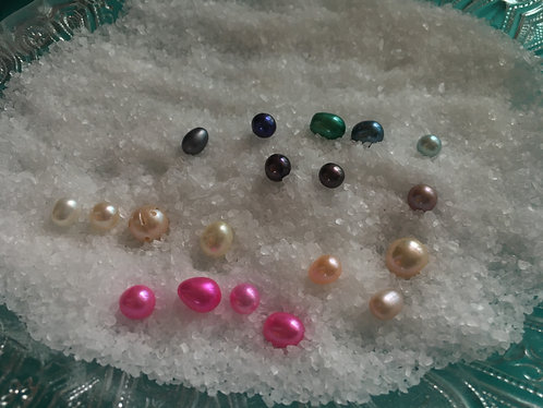 Variety of colors, shapes and size of pearls