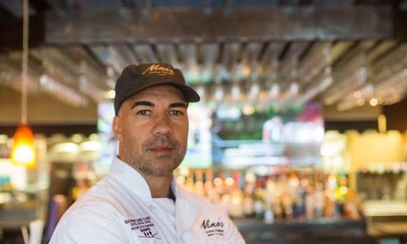 Chef Massimo Mannino poses in Nino's Cucina Italiana in Greenville