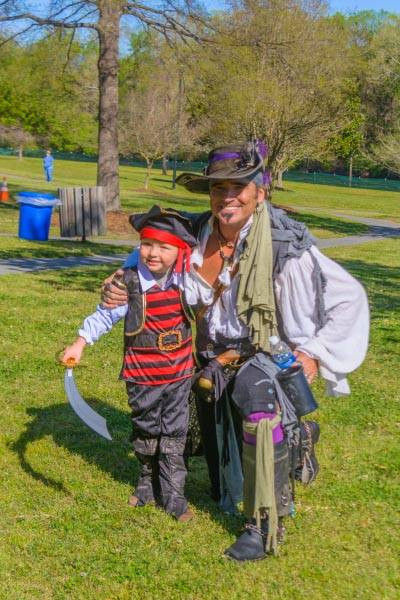 Pirate re-enactor Steve Whetzel poses with a young pirate at Greenville's 2017 PirateFest. (Photo by 252Buzz)
