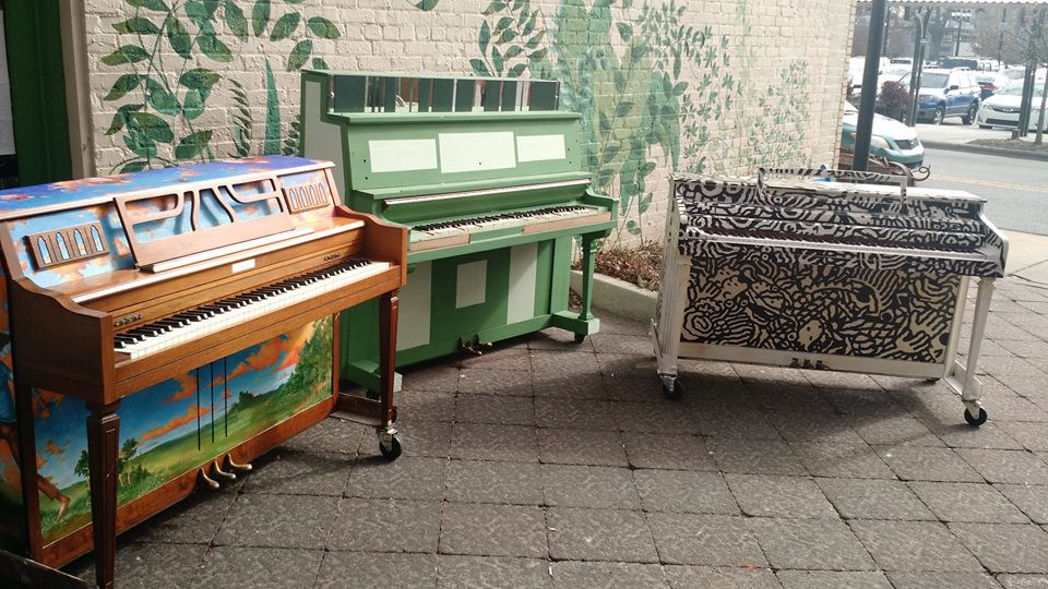 Play Me painted pianos on the patio at Starlight Cafe in Greenville, NC. (Photo via Whirligig Stage)