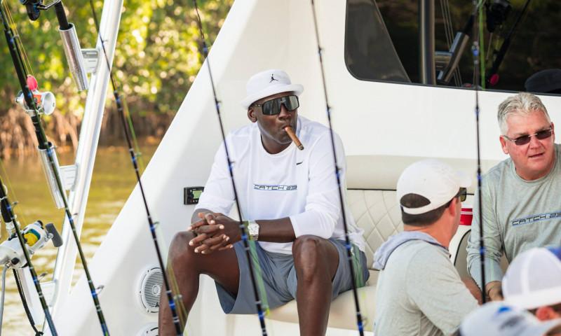 mj smoking cigar on boat